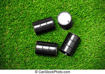 High angle view on four oil barrels on a grass - High angle...