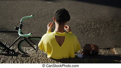 High angle view Transgender adult listening to music in the ...