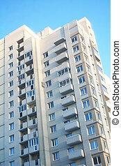 High apartment building on a blue sky