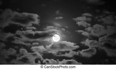 High Bright Moon Among Moving Clouds - Shot of a bright full...