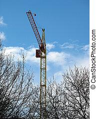 high building crane against the blue sky