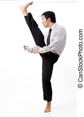 High Business Kick - A young asian businessman in corporate...