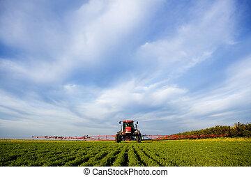 High Clearance Sprayer - A high clearance sprayer on a field...