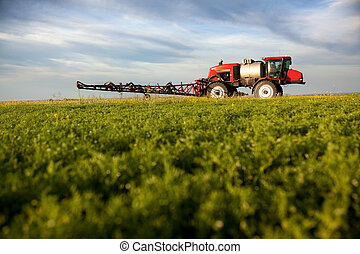High Clearance Sprayer - A high clearance sprayer on a field...