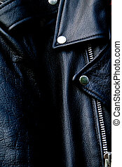 high contrast black leather biker jacket up close