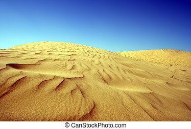 a high constrast, high colour image of a desert sand dune