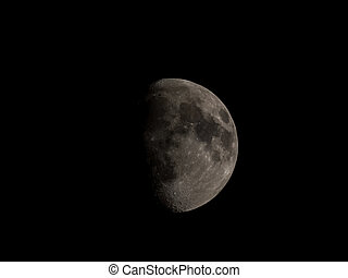High contrast Waxing gibbous moon over dark sky at night