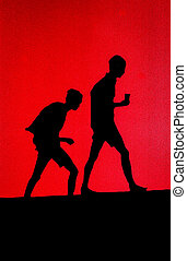 High contrast relief of two boys walking on hill