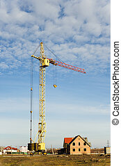 High crane and small house