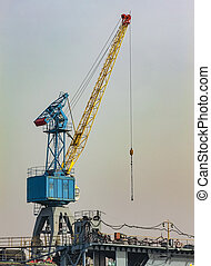 High crane on the construction site