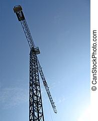 high crane silhouette on blue sky, sunrise - one high crane...