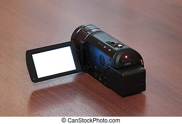 high-definition camera with white screen on a wooden background