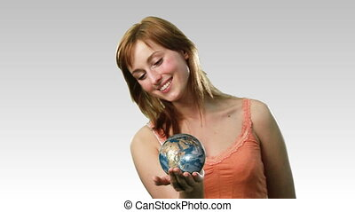 High Definition footage ofan Atractive lady holding the earth