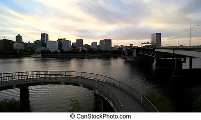 High definition panning movie of downtown skyline along Willamette River waterfront in Portland Oregon at sunset 1080p