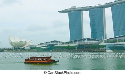 Pleasure boat in the bay near Marina Bay. Singapore