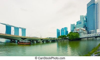 Pleasure boat in the river near bridges. Singapore