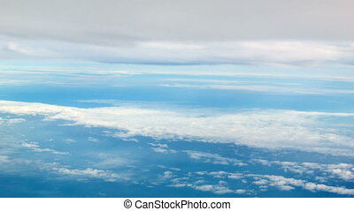 View from the airplane. Clouds above and below