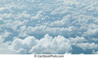 High definition video - View from the airplane. Clouds at a height of several kilometers