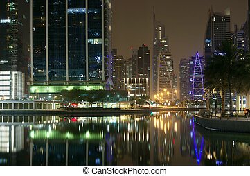 High Dubai skyscrapers of the business city centers in night