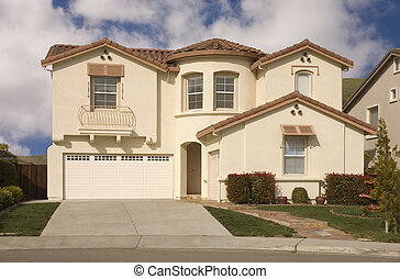 high end tract homein Northern California with ornamental balcony