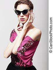 High Fashion. Glamorous Elegant Woman in Dark Sunglasses....