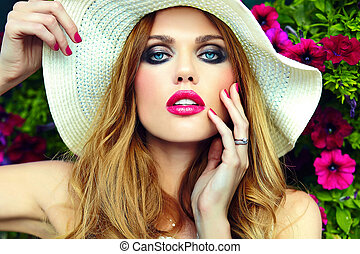 High fashion look. glamor closeup portrait of beautiful sexy stylish blond young woman model with bright makeup and pink lips with perfect clean skin in hat blue eyes