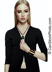 High fashion look. glamor closeup portrait of beautiful sexy stylish blond young woman model with bright yellow makeup with perfect clean skin with gold jewelery in black cloth