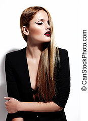 High fashion look. glamor portrait of beautiful sexy stylish Caucasian young woman model in black cloth with bright makeup