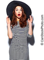 High fashion look. glamor stylish beautiful young happy smiling woman model with red lips in zebra dress in black summer hat