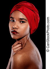 High fashion look. glamour fashion beautiful black American woman with red bright lips with red scarf on head isolated on black