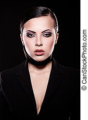 High fashion look. portrait of beautiful brunette girl model in black jacket  with bright makeup and juicy lips. Clean skin. Isolated on black