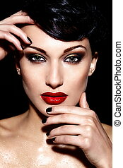 High fashion look.glamor closeup portrait of beautiful sexy brunette Caucasian young woman model with bright makeup, with red lips,  with perfect clean wet  skin