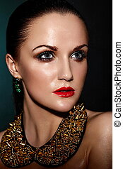 High fashion look.glamor closeup portrait of beautiful sexy brunette Caucasian young woman model with healthy hair,bright makeup, with red lips,  with perfect clean wet skin with accessory jewelery