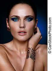 High fashion look.glamor closeup portrait of beautiful sexy Caucasian young woman model with juicy lips,bright blue makeup, with perfect clean skin