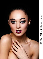 High fashion look.glamor closeup portrait of beautiful sexy Caucasian young woman model with colorful lips,bright black makeup, with perfect clean skin  isolated on black
