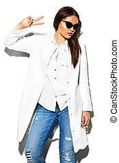 High fashion look.glamor closeup portrait of beautiful sexy stylish brunette business young woman model in white coat jacket hipster cloth in jeans