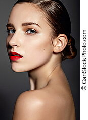 High fashion look.glamor closeup portrait of beautiful sexy stylish brunette Caucasian young woman model with bright makeup, with red lips,  with perfect clean skin in studio