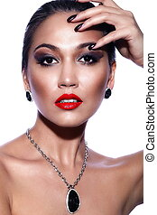 High fashion look.glamor closeup portrait of beautiful sexy brunette Caucasian young woman model with bright makeup, with red lips,  with perfect clean skin with jewelery isolated on white