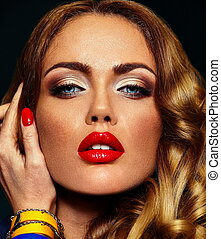 High fashion look.glamor closeup portrait of beautiful sexy stylish blond Caucasian young woman model with bright makeup, with red lips,  with perfect clean skin