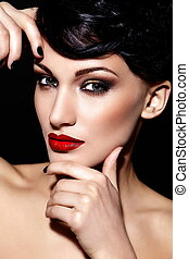 High fashion look.glamor closeup portrait of beautiful sexy brunette Caucasian young woman model with bright makeup, with red lips,  with perfect clean  skin