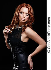 High fashion look.glamor portrait of beautiful sexy redhead stylish Caucasian young woman model with bright makeup, with perfect clean in black dress