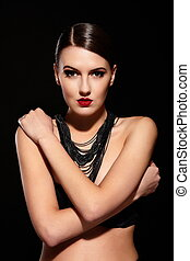 High fashion look.glamor portrait of beautiful sexy Caucasian young woman model with red lips,bright makeup, with perfect clean skin with jewelery isolated black