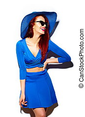 High fashion look.glamor stylish sexy smiling funny beautiful young woman model in summer bright blue casual hipster cloth in sun hat