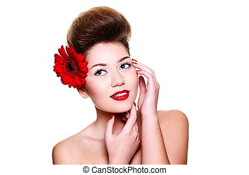 High fashion look.glamour close-up portrait of sexy smiling brunette caucasian young female woman with bright make-up with red lips and red bright manicure with red big flower in hair