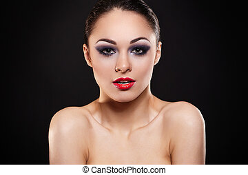 High fashion look.glamour fashion portrait of beautiful sexy brunette girl with bright makeup and red lips on dark