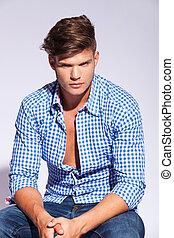 high fashion male model sitting