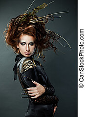High fashion model in black dress, with long nails and ...