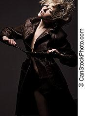 High fashion model in coat posing