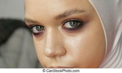 High-fashion. Professional girl model posing on camera in...