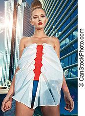 high fashion - Fashion model posing over big city...